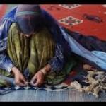 a Qashghai waman weaves a carpet.