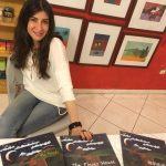 Anahita with copies of The Clever Mouse in Italian, English and Complex Chinese